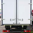 Rear view of new white cargo truck — Stock Photo