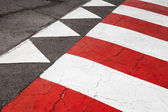 Pedestrian crossing road marking, red white lines and triangles — Stock Photo