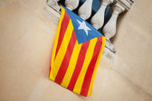 Flag of independent Catalonia hanging on the wall — Stock Photo