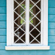 Old Russian rural house fragment, blue wall and white window — Stock Photo #52828175