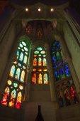 BARCELONA, SPAIN - AUGUST 27, 2014: Tall colorful stained glass windows in La Sagrada Familia - the impressive cathedral designed by Antonio Gaudi — Stock Photo