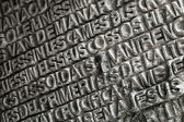 BARCELONA, SPAIN - AUGUST 27, 2014: Words from the Bible in various languages printed on the entrance door of La Sagrada Familia - the impressive cathedral designed by Antonio Gaudi — Stock Photo