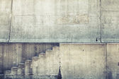 Concrete interior with stairway on the wall, vintage toned background — Stock fotografie
