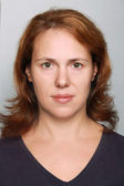 Young Caucasian woman closeup portrait. Headshot on gray — Stock Photo