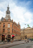 AMSTERDAM, NETHERLANDS - MARCH 19, 2014: Former Amsterdam Main Post Office, currently a shopping mall known as Magna Plaza. Ordinary people walk on the road — Stock Photo