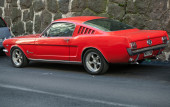 HELSINKI, FINLAND - SEPTEMBER 13, 2014: Red vintage ford mustang 289 stands parked on a street side of Helsinki — Stock Photo
