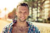 Young smiling Caucasian man outdoor portrait in a summer day — Stock Photo