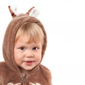 Portrait of smiling Caucasian baby girl in bear costume isolated on white — Stock Photo