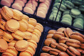 Colorful traditional French macarons lay  in the bakery — Stock Photo