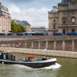 Small industrial boat sails along the quay of river Seine, Paris — Stock Photo #54200443