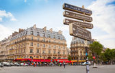 Street view of place Saint-Michel with signpost, Paris — Stock Photo