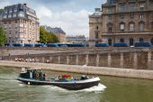 Small industrial boat sails along the quay of river Seine, Paris — Stock Photo