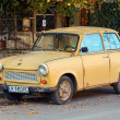 Old yellow Trabant 601s car stands parked on a street side — Stock Photo #54634635