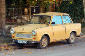 Old yellow Trabant 601s car stands parked on a street side — Стоковое фото