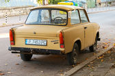 Old yellow Trabant 601s car stands parked on a street — Stock Photo