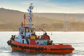 Red tug is underway on Black sea, Varna harbor, Bulgaria — Stock Photo