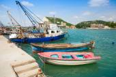 Fishing and small wooden boats are moored in port — Stock Photo