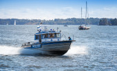 Fast water police motor boat with policemen. Helsinki, Finland — Stock Photo