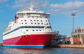 Red and white passenger ferry is moored in port — Foto Stock