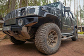 Black Hummer H2 car stands on dirty road — Stock Photo