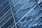 Modern metal scaffolding on wall, blue toned — Stockfoto