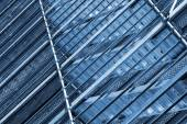 Modern metal scaffolding on wall, blue toned — Stock fotografie
