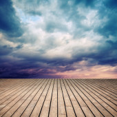 Wooden floor with perspective and stormy sky — Stok fotoğraf