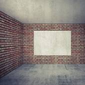 Empty room interior with red brick walls and empty white poster — Stock Photo
