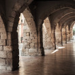 Old stone archway. Street of Tarragona, Spain — Stock Photo #56663595
