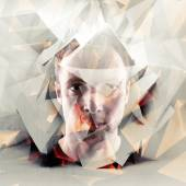 Stylized artistic young man portrait with chaotic polygons — Stock Photo