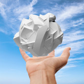 Male hand holding white flying fragmented 3d object — Stock Photo