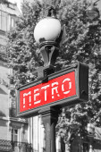 Street sign at the entrance to the Paris Metro, red banner on the street lamp, tonal correction effect — Stock Photo