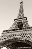 Looking up on Eiffel Tower, the most popular landmark of Paris, France. Monochrome vertical photo — Stock Photo