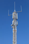 Communication tower with GSM and radio devices — Stock Photo