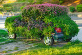 Conceptual flower decoration of old car — Stock Photo