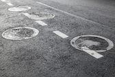 Sewer manholes on asphalt road pavement — Stock Photo