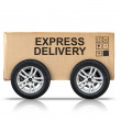 Cardboard box with standard signs on automotive wheels — Stock Photo #57846121