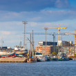 Coastal cityscape of modern Helsinki with cranes and ships — Stock Photo #57846175