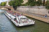 White passenger touristic ship operated by Bateaux-Mouches — Stock Photo