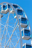 Ferris wheel over clear blue sky — Stock Photo
