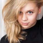 Smiling Caucasian girl with long blond hair, studio portrait — Stock Photo #58829303