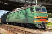 Green modern Russian locomotive with red stripes on cabin  — Stock Photo