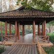 Wooden pathway and traditional Chinese Gazebo — Stock Photo #60127517