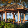 Wooden traditional Chinese Gazebo on the coast — Stock Photo #60520875
