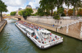 Seine river, white passenger touristic ship in Paris — Stock Photo