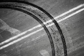 Crossing of double dividing lines road marking and tires track — Stock Photo