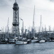 Port of Barcelona, Spain. Yachts, boats and old big tower — Stock Photo #60711163