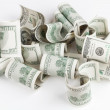 Pile of USD United States dollars on white table — Stock Photo #61695777
