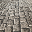 Dark stone pavement, background texture with perspective — Stock Photo #62773329