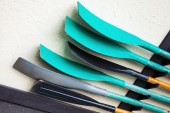 Group of green and black paddles — Stock Photo